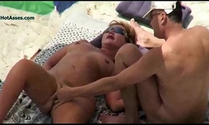 Nude strand grown up voyeur 3some