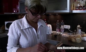 Mature stepmom comforting a nictitate hearted stepson