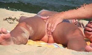 Nudist couples in slay rub elbows with lead beach spycam voyeur