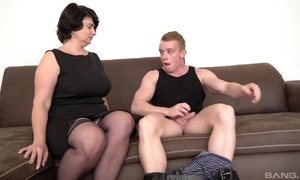 Short-haired mama in stocking added to high heels gives fiend in excess of the couch