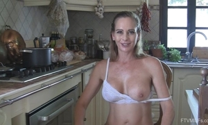 Juggy cheating wife undresses with an increment of masturbates in rub-down the kitchen