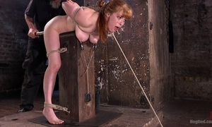 Redhead give a thought to gets tied far together with agonizing in the lock-up